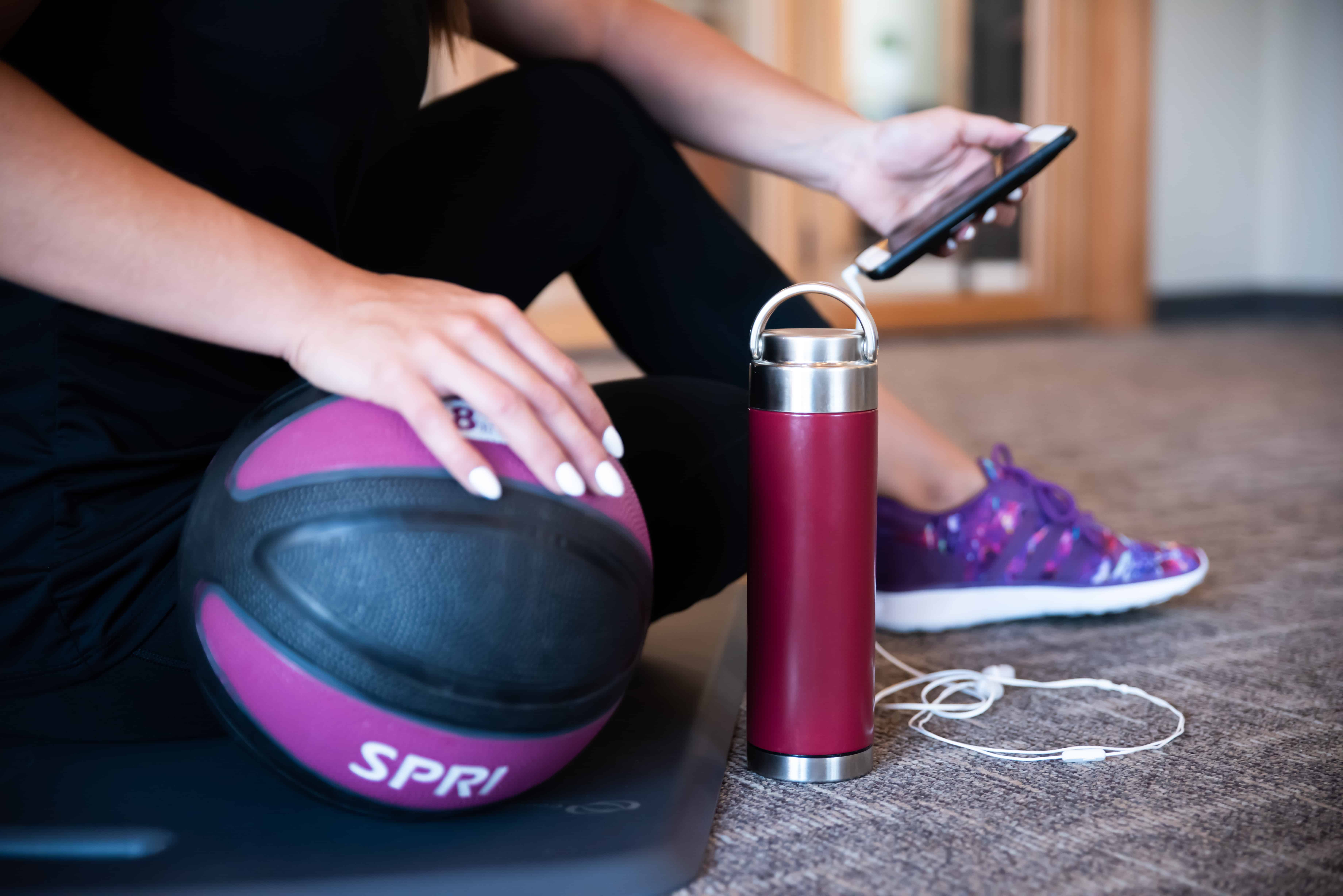 stainless steel reusable water bottle at gym